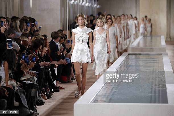Models present creations for Balenciaga during the 2016 Spring/Summer readytowear collection fashion show on October 2 2015 in Paris AFP PHOTO /...