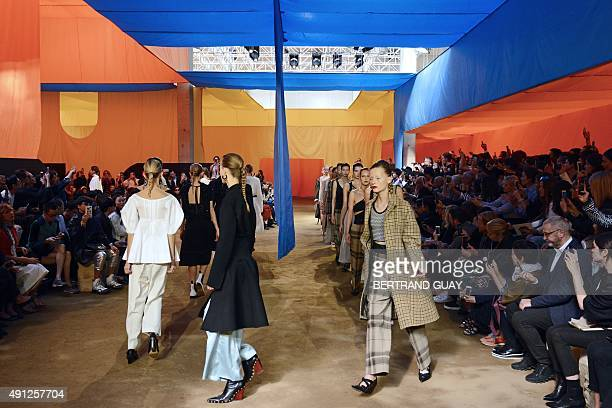 Models present creations for Celine during the 2016 Spring/Summer readytowear collection fashion show on October 4 2015 in Paris AFP PHOTO / BERTRAND...