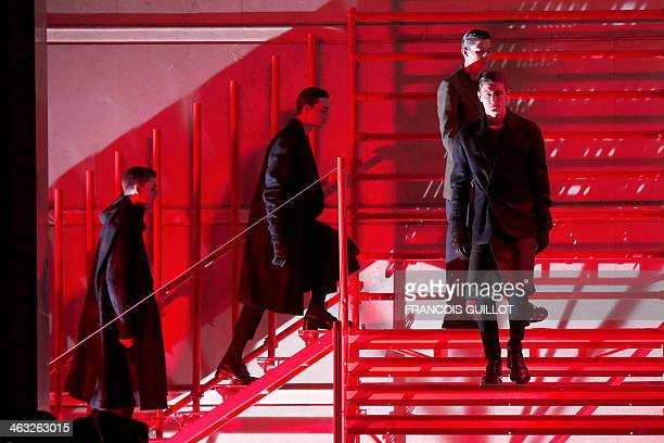 Models present creations for Cerruti 1881 during the Fall/Winter 20142015 men's fashion show in Paris on January 17 2014 AFP PHOTO FRANCOIS GUILLOT