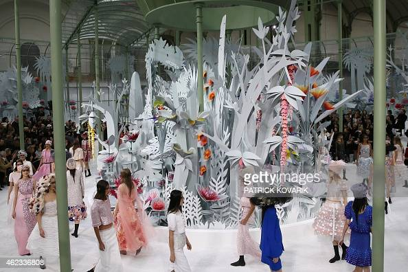 Models present creations for Chanel during the 2015 Haute Couture SpringSummer collection fashion show on January 27 2015 at the Grand Palais in...