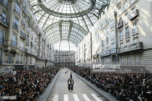 Models present creations for Chanel during the 2015 Spring/Summer readytowear collection fashion show on September 30 2014 at the Grand Palais in...