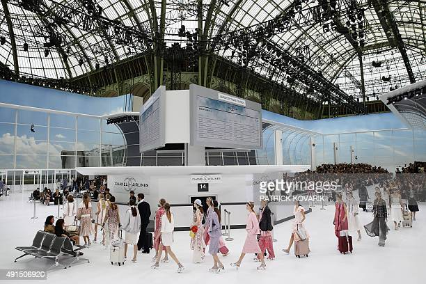 Models present creations for Chanel during the 2016 Spring/Summer readytowear collection fashion show on October 6 2015 at the Grand Palais in Paris...