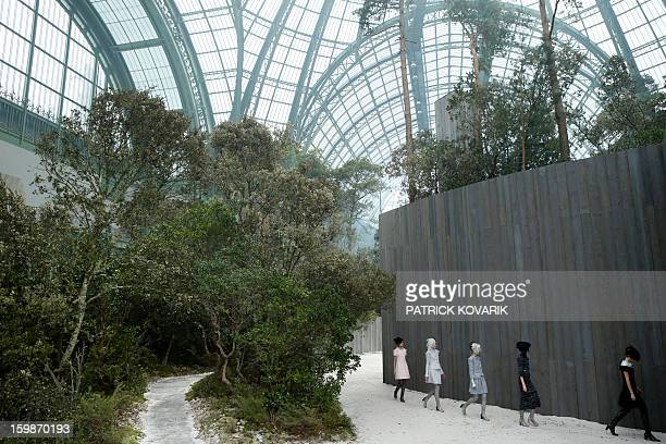 Models present creations for Chanel during the Haute Couture SpringSummer 2013 collection shows on January 22 2013 at the Grand Palais in Paris AFP...
