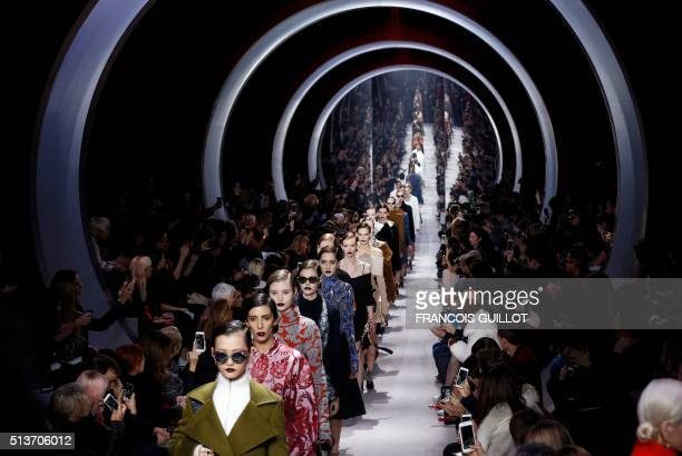 Models present creations for Christian Dior during the 20162017 fall/winter readytowear collection fashion show on March 4 2016 in Paris / AFP PHOTO...
