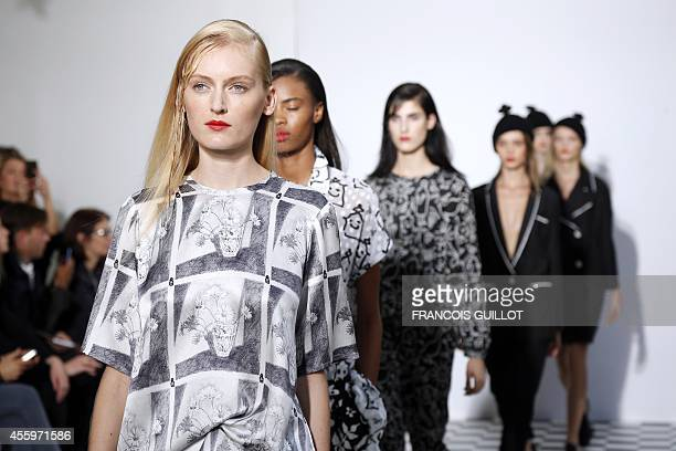 Models present creations for Devastee during the 2015 Spring/Summer readytowear collection fashion show on September 23 2014 in Paris AFP PHOTO /...