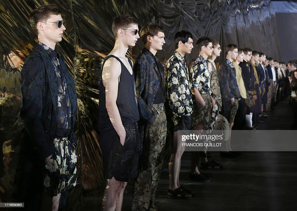 Models present creations for Dries Van Noten fashion house during the men's ready-to-wear fashion shows on June 27, 2013 in Paris. AFP PHOTO / FRANCOIS GUILLOT