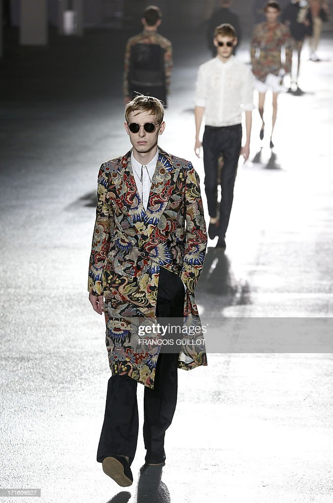 Models present creations for Dries Van Noten fashion house during the men's ready-to-wear fashion shows on June 27, 2013 in Paris.