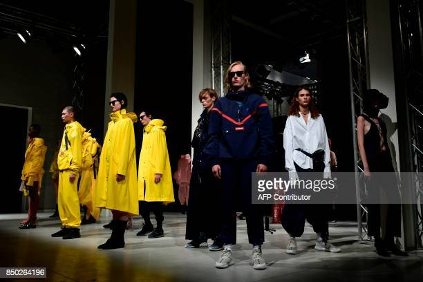 Models present creations for fashion house Angel Chen during the Women's Spring/Summer 2018 fashion shows in Milan on September 20 2017 / AFP PHOTO /...
