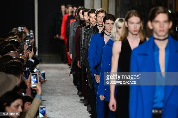 Models present creations for fashion house Costume National during the Men Fall Winter 2016 / 2017 collection shows at the Milan's Fashion Week on...