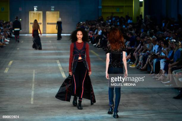 Models present creations for fashion house Diesel Black Gold during the Men's Spring/Summer 2018 fashion shows in Milan on June 17 2017 / AFP PHOTO /...