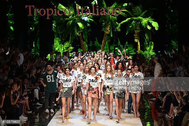 Models present creations for fashion house Dolce Gabbana during the 2017 Women's Spring / Summer collections shows at Milan Fashion Week on September...