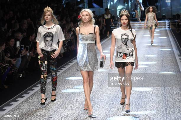 TOPSHOT Models present creations for fashion house Dolce Gabbana during the Women's Fall/Winter 2017/2018 fashion week in Milan on February 26 2017 /...