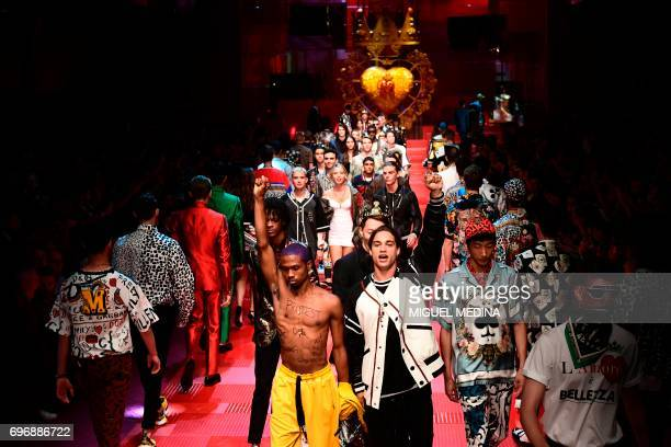 Models present creations for fashion house Dolce Gabbana during the Men's Spring/Summer 2018 fashion shows in Milan on June 17 2017 / AFP PHOTO /...