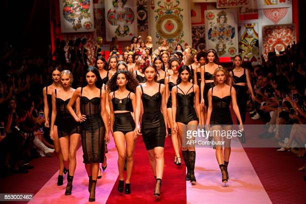 Models present creations for fashion house Dolce Gabbana during the Women's Spring/Summer 2018 fashion shows in Milan on September 24 2017 / AFP...