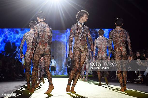 Models present creations for fashion house Dsquared2 at the Men SpringSummer 2016 Milan's Fashion Week on June 23 2015 AFP PHOTO / OLIVIER MORIN