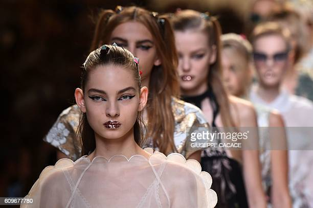 Models present creations for fashion house Fendi during the 2017 Women's Spring / Summer collections shows at Milan Fashion Week on September 22 2016...