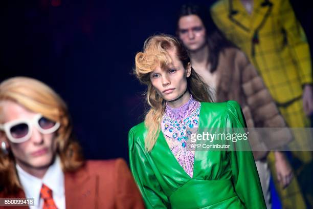 Models present creations for fashion house Gucci during the Men and Women's Spring/Summer 2018 fashion shows in Milan on September 20 2017 / AFP...