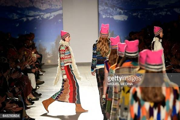 TOPSHOT Models present creations for fashion house Missoni during the Women's Fall/Winter 2017/2018 fashion week in Milan on February 25 2017 / AFP /...