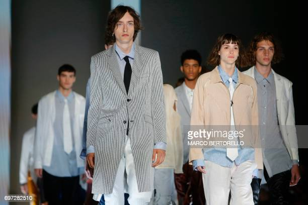 Models present creations for fashion house Sulvam during the Men's Spring/Summer 2018 fashion shows in Milan on June 18 2017 / AFP PHOTO / Marco...