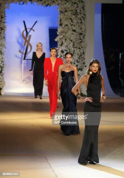 Models present creations for French designer Yves Saint Laurent 22 January 2002 during the retrospective part of Saint Laurent's last ever show at...