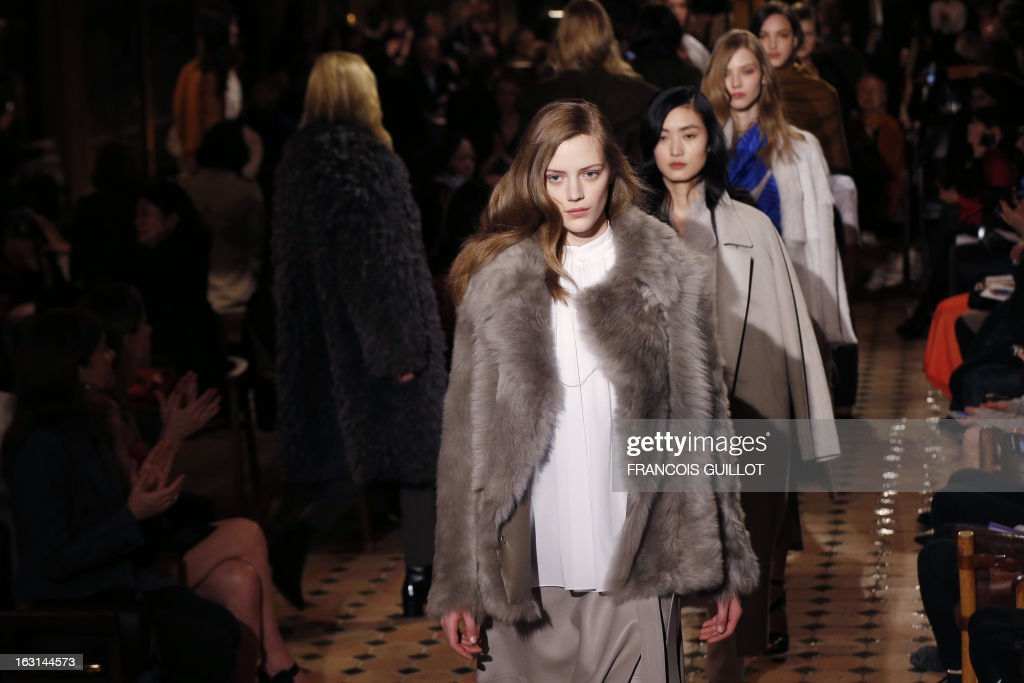 Models present creations for Hermes during the Fall/Winter 2013-2014 ready-to-wear collection show, on March 5, 2013 in Paris.
