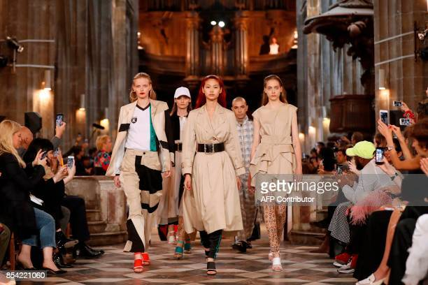 Models present creations for Koche at the end of the women's 2018 Spring/Summer readytowear collection fashion show in Paris on September 26 2017 /...