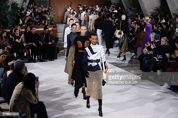 Models present creations for Loewe during the 20162017 fall/winter readytowear collection on March 4 2016 in Paris AFP PHOTO / FRANCOIS GUILLOT / AFP...
