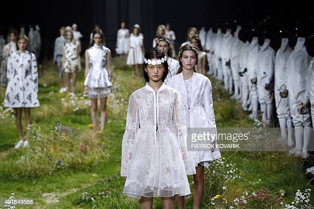 Models present creations for Moncler Gamme Rouge during the 2016 Spring/Summer readytowear collection fashion show on October 7 2015 in Paris AFP...