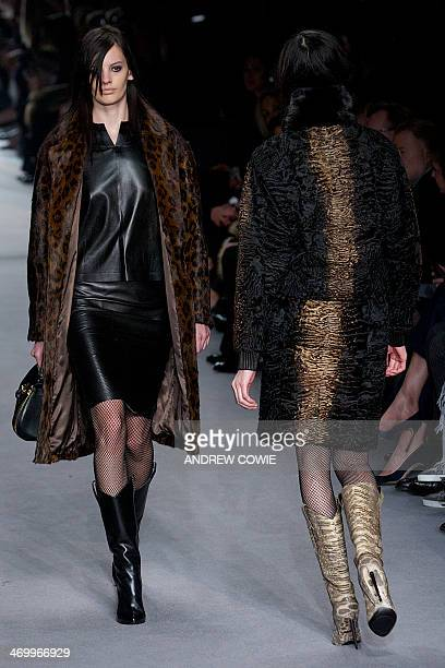 Models present creations for the Tom Ford Show during the 2014 Autumn / Winter London Fashion Week in London on February 17 2014 AFP PHOTO / ANDREW...