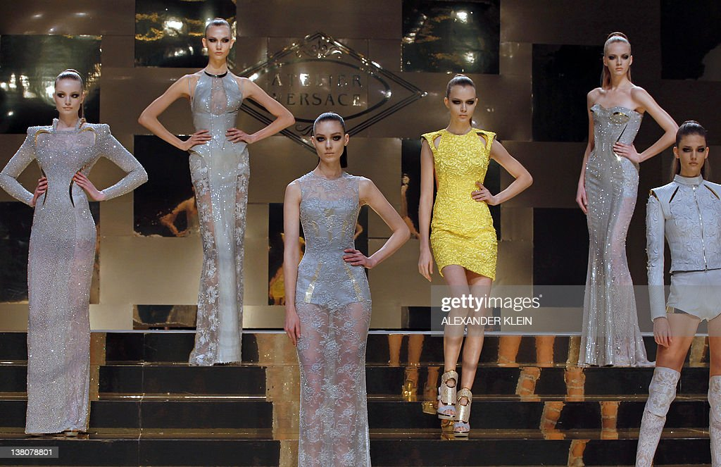 Models present creations for Versace Atelier line during the Spring/Summer 2012 Haute Couture collection show on January 23 2012 in Paris AFP...