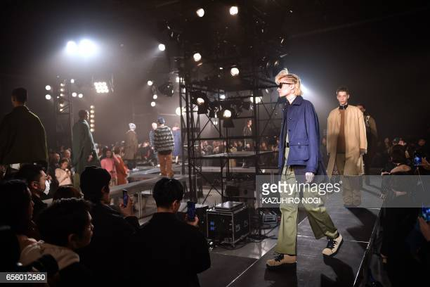 Models present creations from Name by Japanese designer Noriyuki Shimizu during the 2017 Autumn/Winter Collection show at Tokyo Fashion Week in Tokyo...