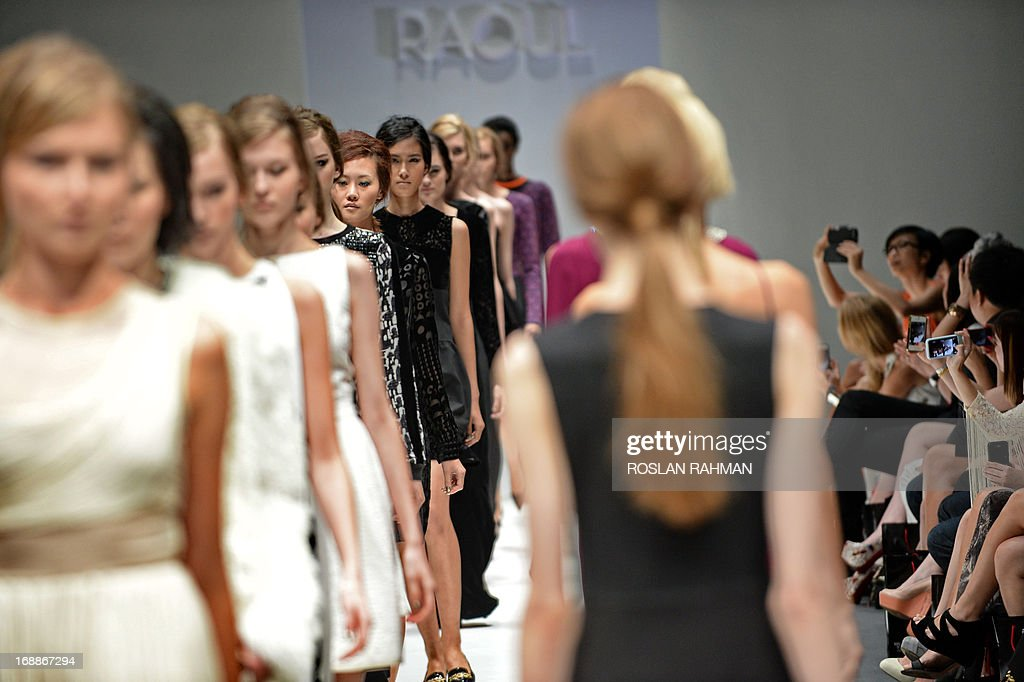 Models present creations from Raoul's Autumn/Winter 2013 collection during the Audi Fashion Festival in Singapore on May 16, 2013.