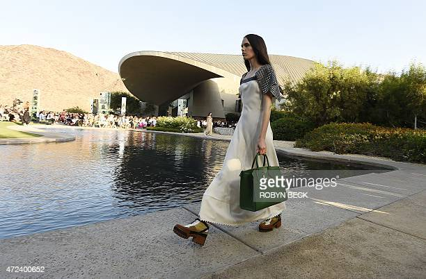 Models present creations from the Louis Vuitton 2016 cruise collection designed by Nicolas Ghesquière May 6 at the Bob and Dolores Hope Estate in...
