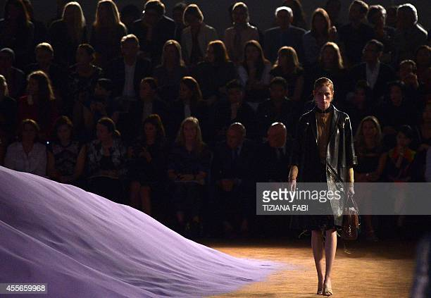 Models present creations from the Prada collection during the 2015 Spring / Summer Milan Fashion Week on September 18 2014 in Milan AFP PHOTO /...