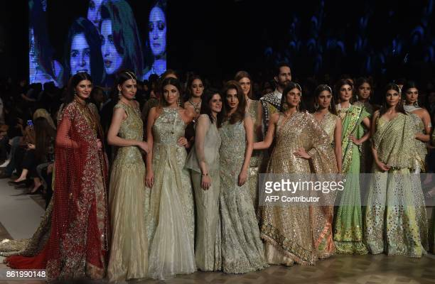 Models present creations of a Pakistani designer Tabya Khan during the final day of the Pakistan Fashion Design Council LOreal Paris Bridal Week in...