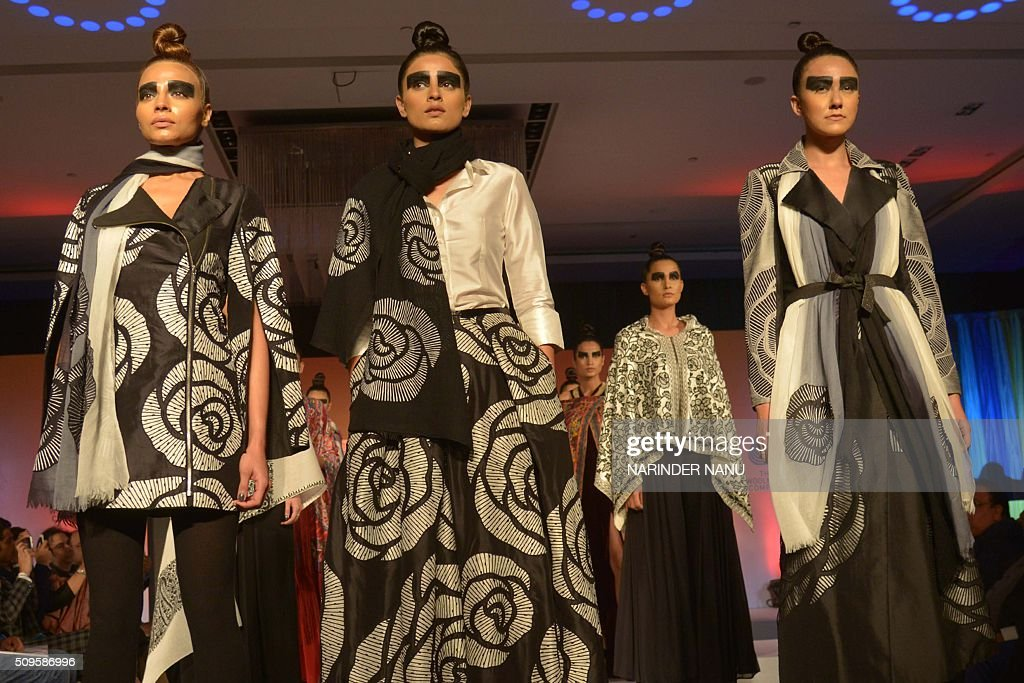 Models present creations of Indian fashion designer Nachiket Barve during a fashion show organised by Woolmark at a hotel in Amritsar on February 11, 2016. The seminar was followed by a fashion show displaying an exclusive collection of stylish Australian Merino wool shawls and stoles. The Woolmark company has also convinced its partners to go in for innovative designs as traditional products might not get buyers in this not-so-cold winter. Woolmark has 121 partners, which include manufacturers of shawls, stoles and knitwear spread across Punjab and other north Indian cities. / AFP / NARINDER NANU