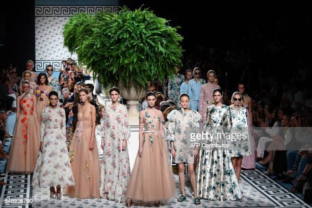 TOPSHOT Models present creations of Jorge Vazquez's Spring/Summer 2018 collection during the Madrid Fashion Week in Madrid on September 18 2017 / AFP...