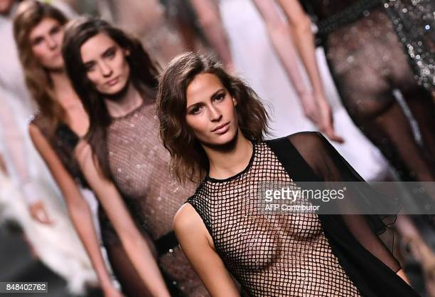 Models present creations of Juana Martin's Spring/Summer 2018 collection during the Madrid Fashion Week in Madrid on September 17 2017 / AFP PHOTO /...