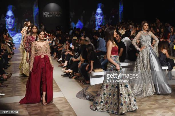 Models present creations of Pakistani designer Zuria during the final day of the Pakistan Fashion Design Council LOreal Paris Bridal Week in Lahore...