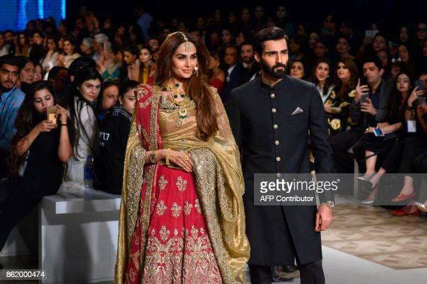 Models present creations of Pakistani designers Shazia and Sehr during the final day of the Pakistan Fashion Design Council LOreal Paris Bridal Week...