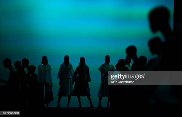TOPSHOT Models present creations of Ulises Merida's Spring/Summer 2018 collection during the Madrid Fashion Week in Madrid on September 15 2017 / AFP...
