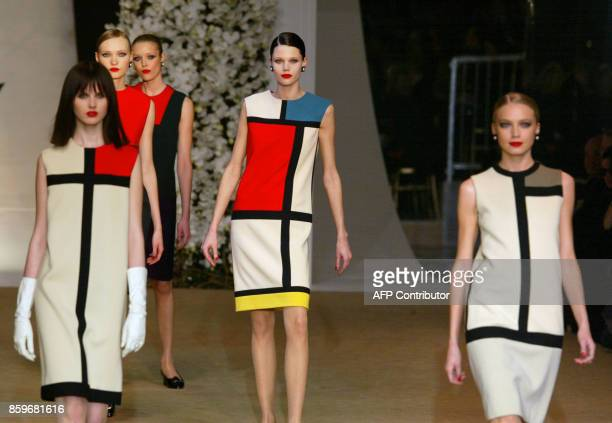Models present dresses by French designer Yves saintLaurent inspired in 1965 by the work of Dutch painter Piet Mondrian 22 January 2002 during...