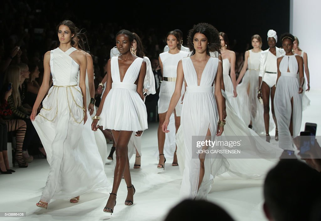 Models present fashion by Greek-Italian designer Dimitri from the Spring/Summer 2017 collections at the Fashion Week in Berlin on June 30, 2016. / AFP / dpa / Jörg Carstensen / Germany OUT