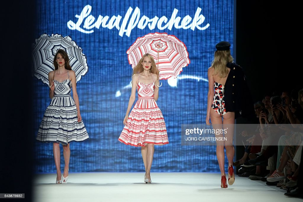 Models present fashion of the Austrian designer Lena Hoschek from the Spring/Summer 2017 collections at the Fashion Week in Berlin on June 30, 2016. / AFP / dpa / Jörg Carstensen / Germany OUT