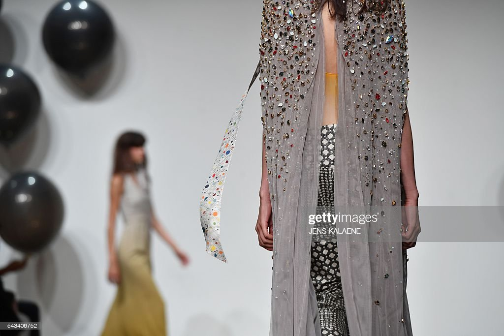 Models present fashion of the German-Polish label Dawid Tomaszewski from the Spring/Summer 2017 collections at the Fashion Week in Berlin on June 28, 2016. / AFP / dpa / Jens Kalaene / Germany OUT