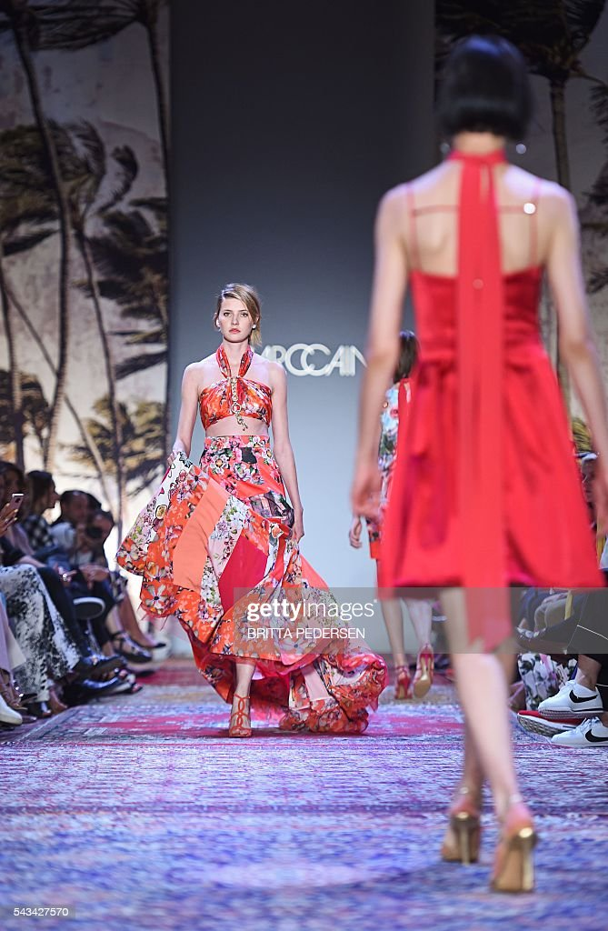 Models present fashion of the label Marc Cain from the Spring/Summer 2017 collections at the Fashion Week in Berlin on June 28, 2016. / AFP / dpa / Britta Pedersen / Germany OUT