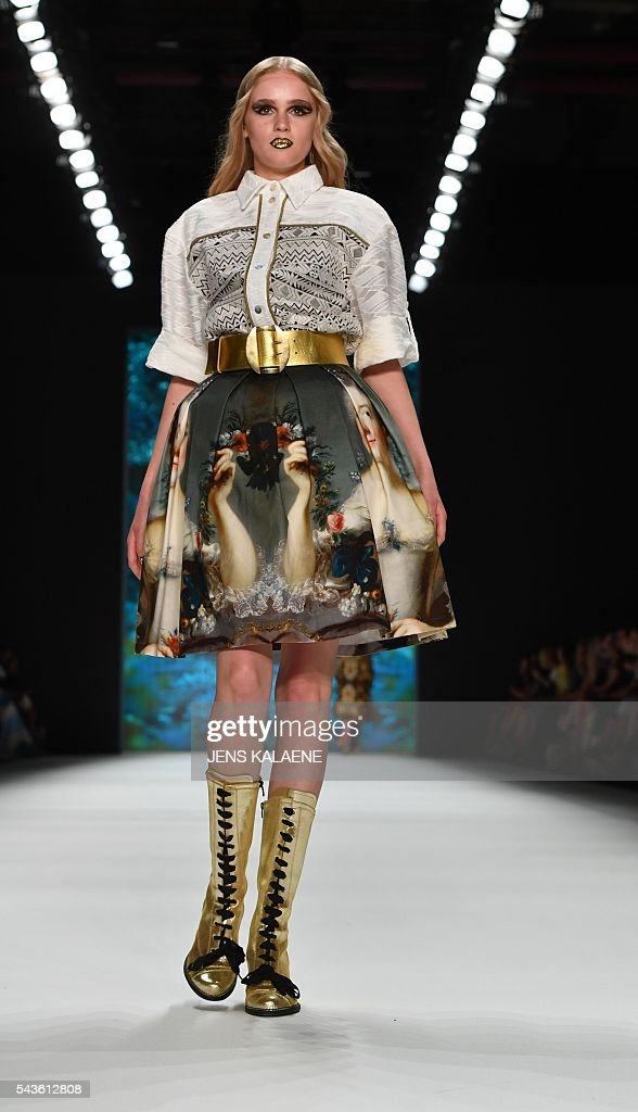 Models present fashion of the label Rebecca Ruetz from the Spring/Summer 2017 collections at the Fashion Week in Berlin on June 29, 2016. / AFP / dpa / Jens Kalaene / Germany OUT