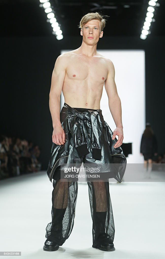 Models present fashion of the Swedish label Odeur from the Spring/Summer 2017 collections at the Fashion Week in Berlin on June 28, 2016. / AFP / dpa / Jörg Carstensen / Germany OUT