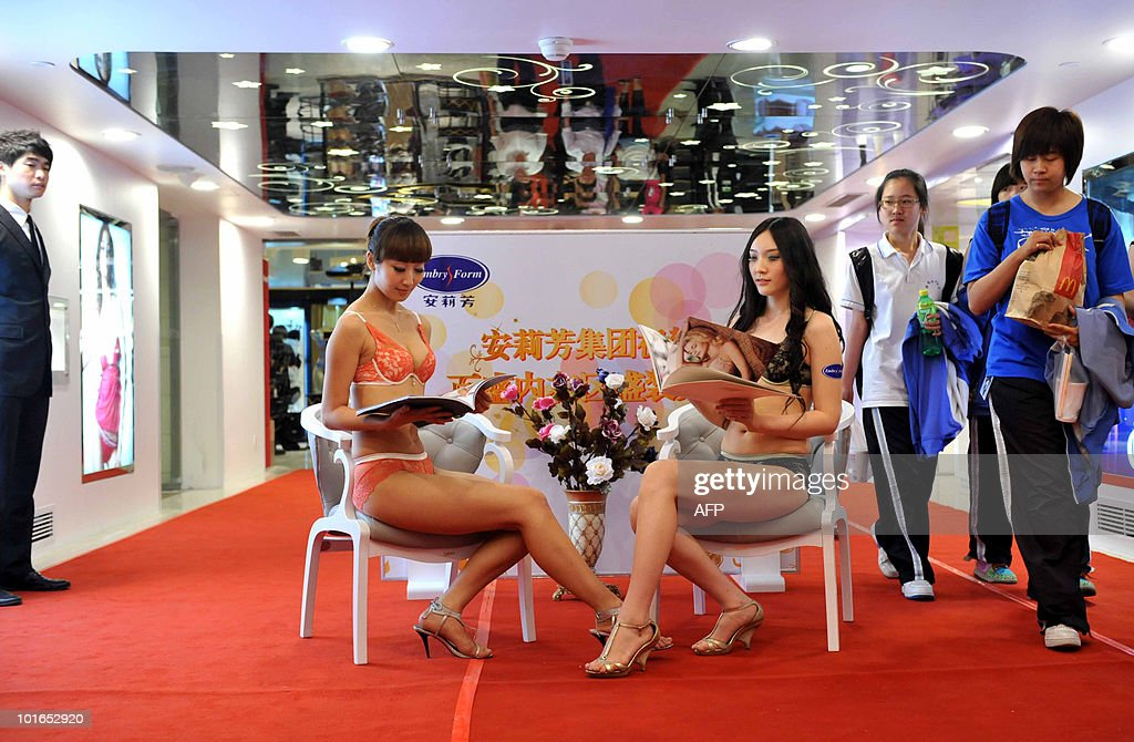 Models present lingerie at a newly opened shop in Beijing on June 5, 2010. Women have become a major driving force behind China's economic growth, as the country's overall retail sales rose 15 percent in 2009, driven in large part by women under the age of 35. CHINA
