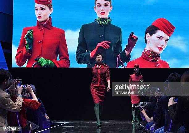 Models present new uniforms for hostesses of Italian airline Alitalia by designer Ettore Bilotta during a press conference on May 18 2016 in Rome /...